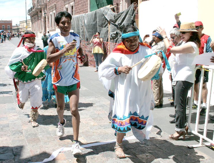 The winner, a young Tarahumara who raced in running shoes, not huaraches!